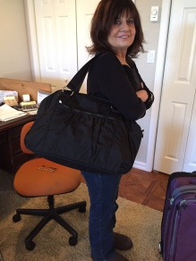 The Mamabella models the Le Sportsac Abby Carry-On.